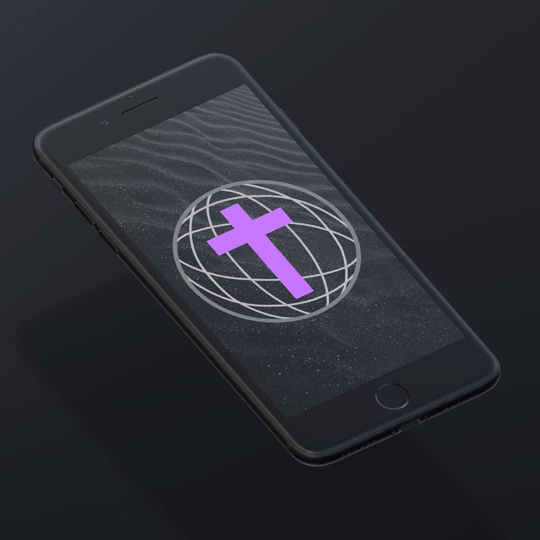 Telefon z wyświetlonym logo Platformy Diecezji Gliwickiej
